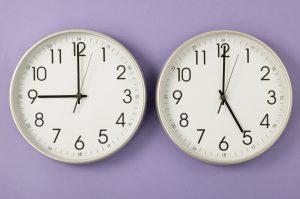 Detail view of two clocks running on different times